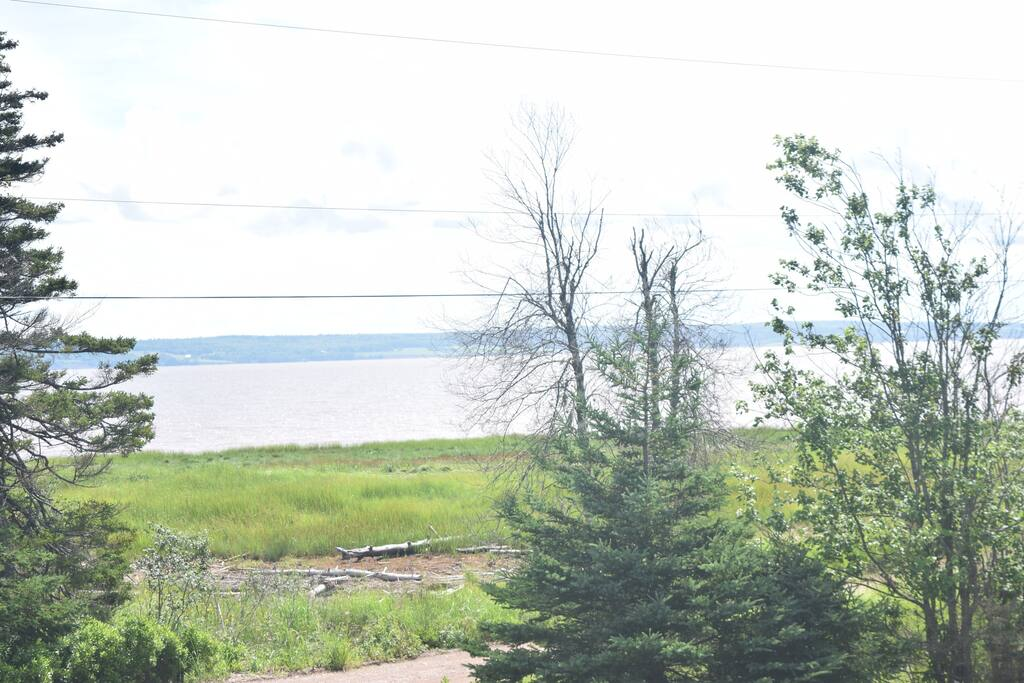 Enjoy the view of the Cobequid Bay and the highest tides, as the Tidal Bore roles by. When the tide is out can explore the beach and mud slide if you dare but keep an eye on the incoming tide as is the highest in the world. When the tide is on the way in get ready to go bass fishing. Enjoy the  bird watching, the privacy, the sound of the tide. Located on a narrow one lane dirt road where neighbours watch out for one another and bicycles are welcome. No motorized vehicles on the beach. Escape to this rustic two storey retreat with all the amenities when you are feeling tired out. Relax and enjoy.