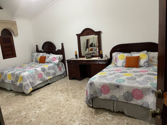 Bedroom number 3. Two queen size beds, cable tv, Ac, bathroom .