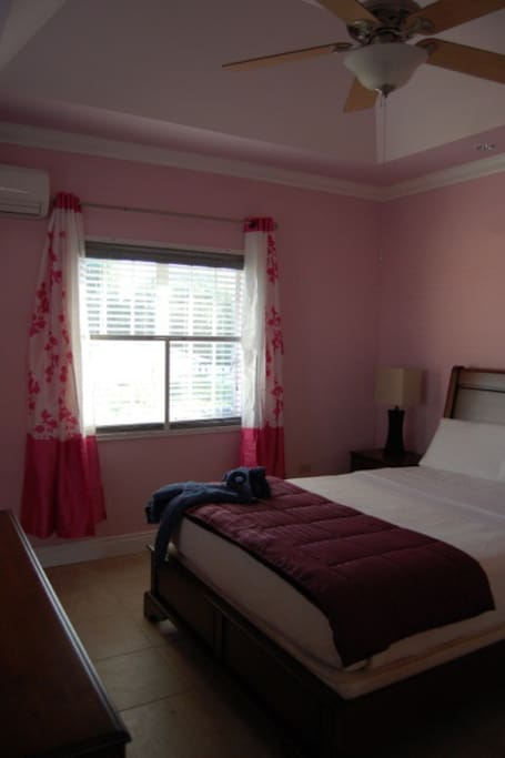 Pink Bedroom. Has 2 queen beds