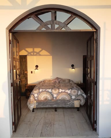 Queen bed and open doors to fully enjoy the gorgeous and spaceous views.