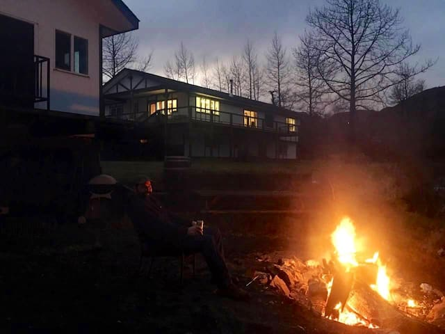 The fire pit down by the river looking up to the Eider-house bnb and Vacation Rental.