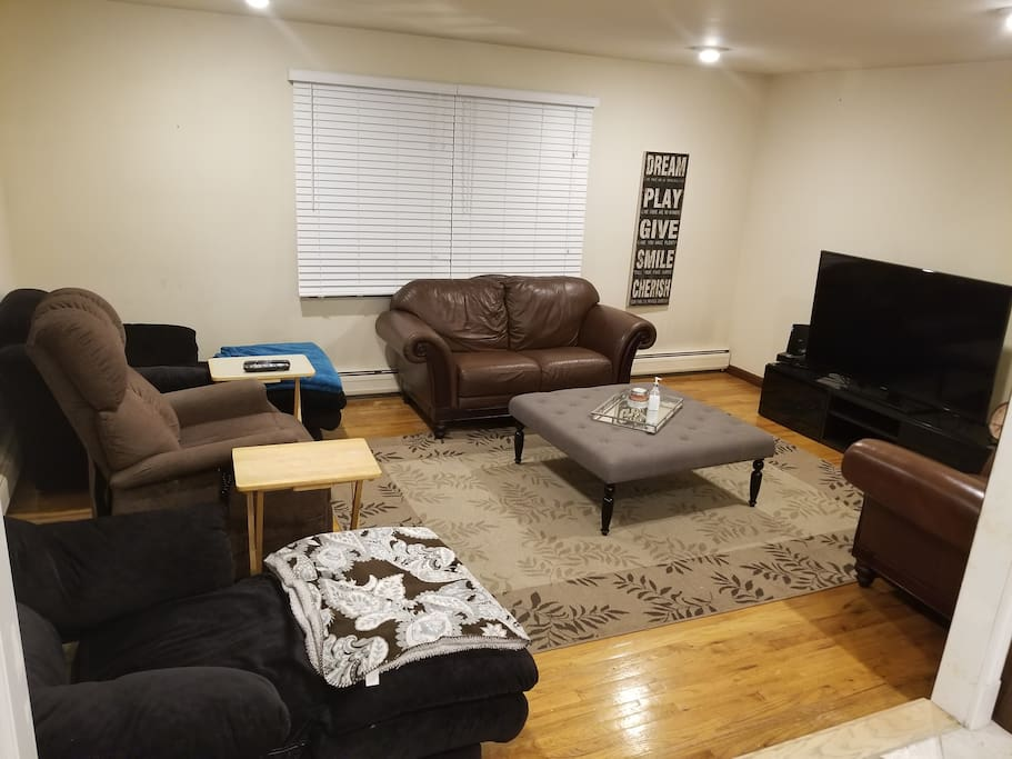 "Living room with a 60"" tv with cable."