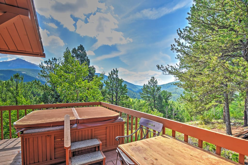 Treat yourself to a private mountain getaway with this Divide vacation rental cabin!