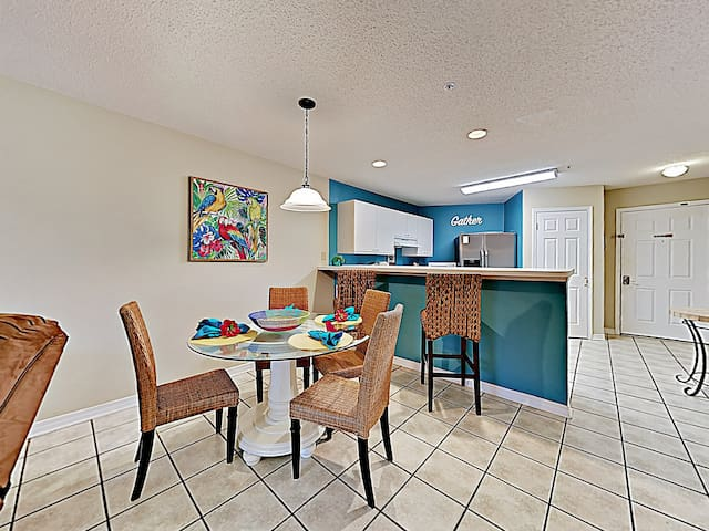 Enjoy home-cooked meals at a glass-top table for 4 in the dining area.