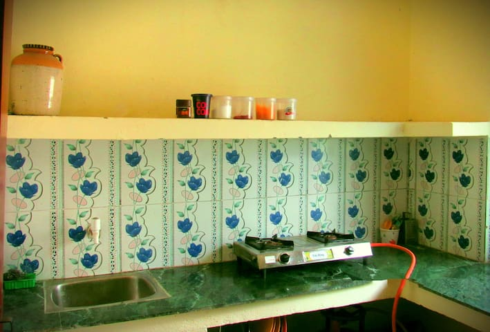 Kitchen, from where guests can cook meals. The kitchen is equipped with a gas stove, utensils, cutlery, crockery are available, a water filter and an electric kettle.