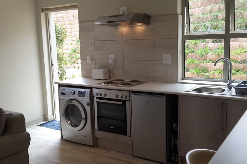 bright, modern kitchen with all the necessary amenities, including a washing machine/tumble-dryer, microwave, toaster, all crockery, cutlery, etc.