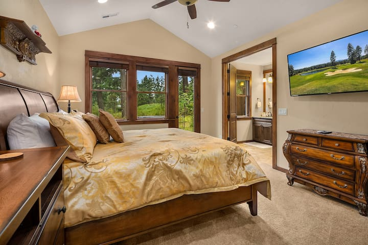 Main floor king master with direct access to the back patio and hot tub.