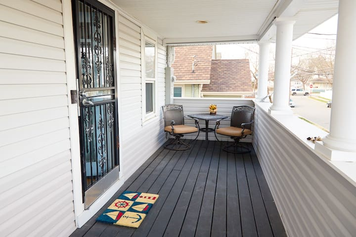 FRONT PORCH:  Enjoy the sunrise in the outdoor eating nook.