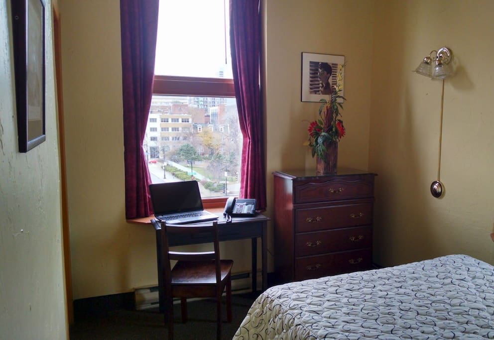 Guest room, 1 double bed.  Work space with nice view of Montreal.