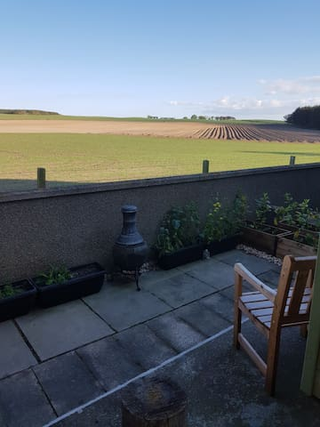 Private rear terrace at back of accommodation backing onto farm.