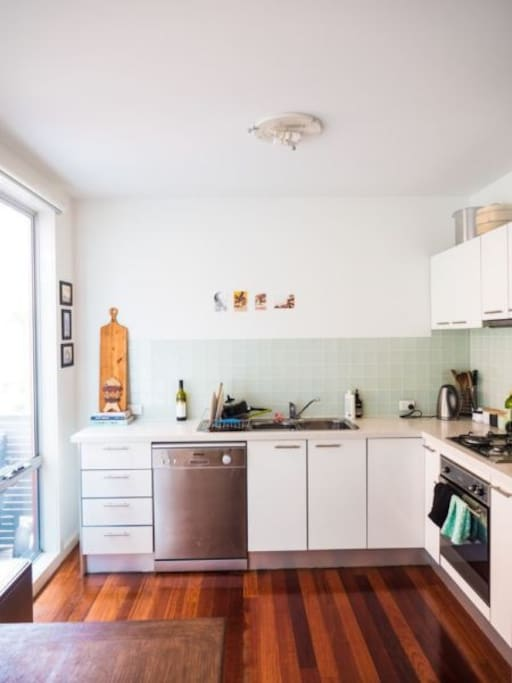 Cute open kitchen with all the basics and a gas stove