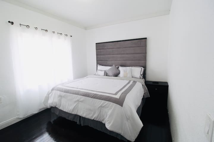 Warm bedroom with double bed and one bedside table