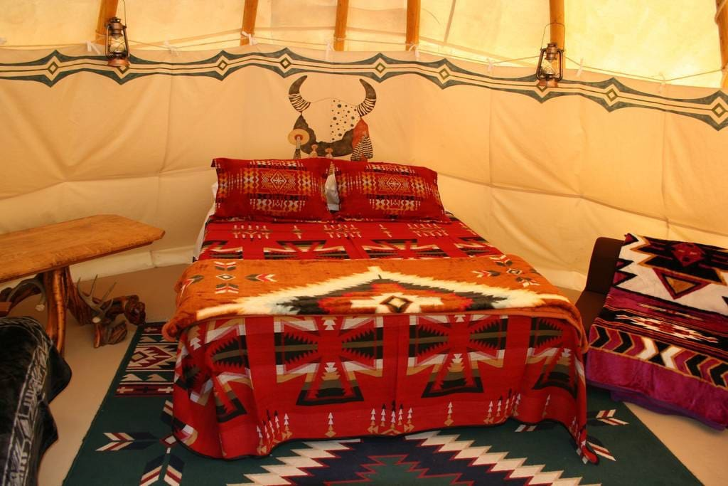 A brand new Queen Bed with warm blankets and flannel sheets makes Tipi glamping the most magical experience. Your electric fireplace will keep the chill off.