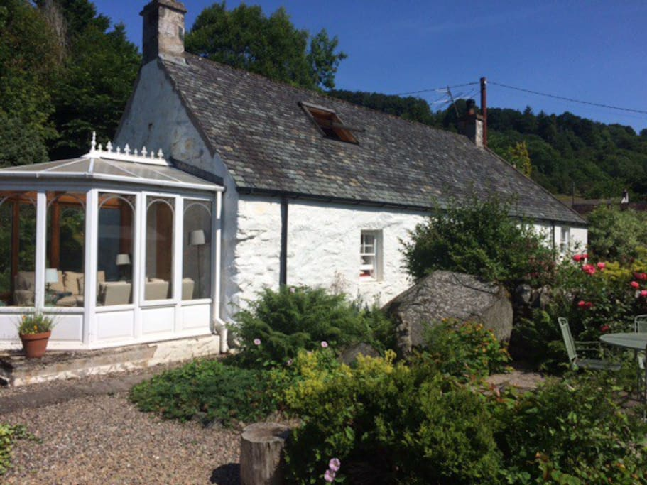 Sunny Conservatory and secluded garden with Drummond Hill behind. There are numerous beautiful Forrest walks on Drummond hill accessible on foot from the cottage