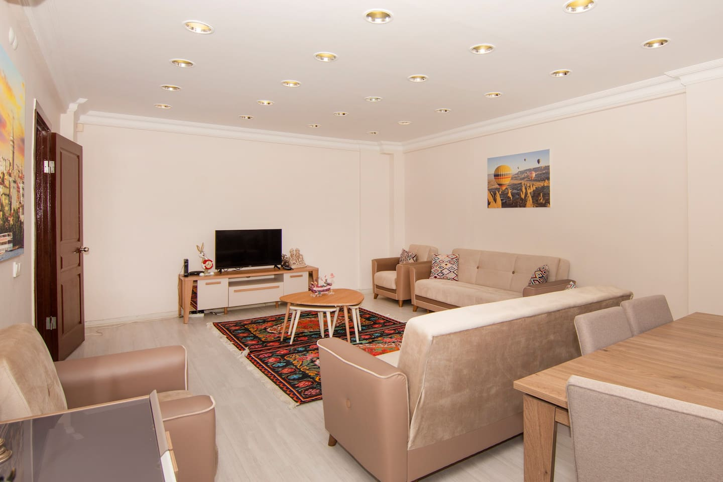 Modernly furnished living room that has a cable TV.                     (Air conditioned)
