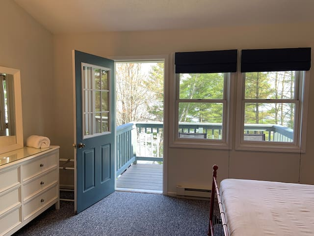 Bedroom features walk-out private lounge balcony overlooking Lake Superior and the Apostle Islands.