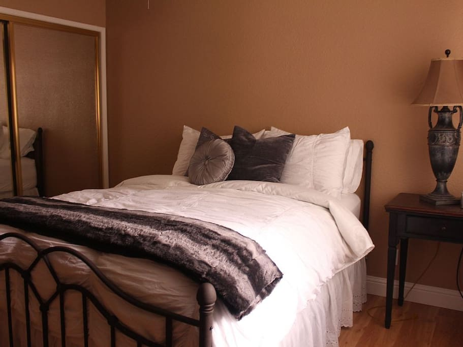 Second Bedroom with queen bed, luxurious linens.