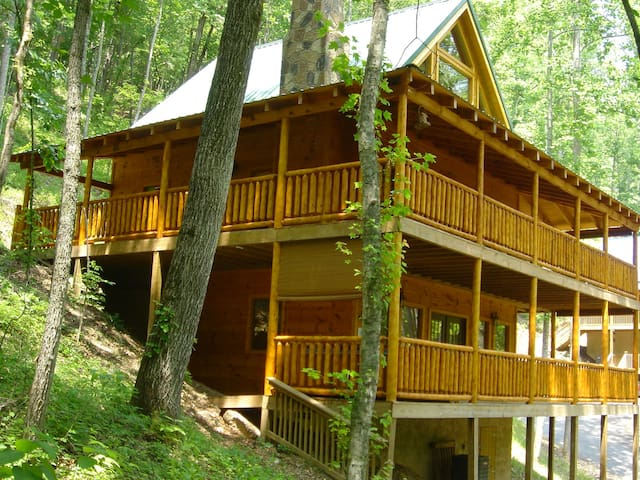 Two floors of wrap-around hand-peeled log porches.