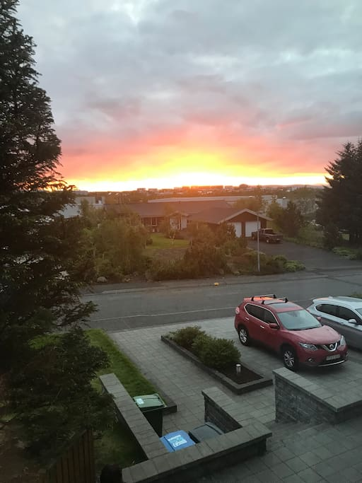The Icelandic summer midnight sunset seen from the living room window