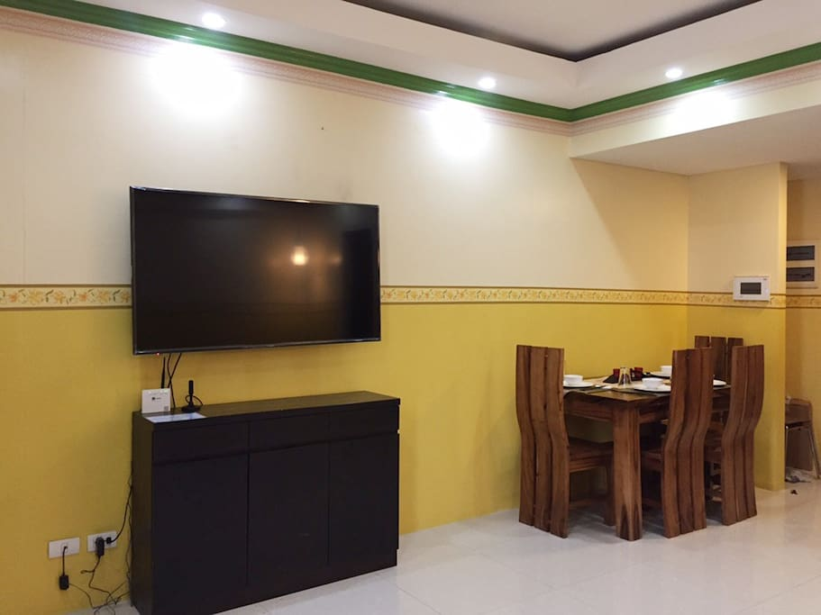 "Living Area - Full HD 55""TV Dining Area - 4 wooden chairs and 1 big table"