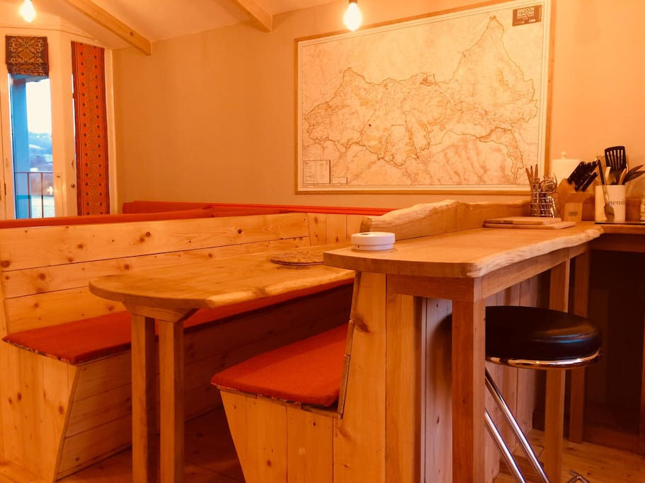 Solid bespoke oak dining table and bench seating offer ample room
