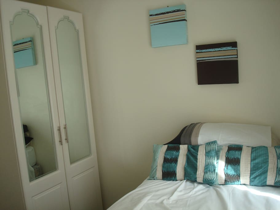 Comfortable single bed and double wardrobe