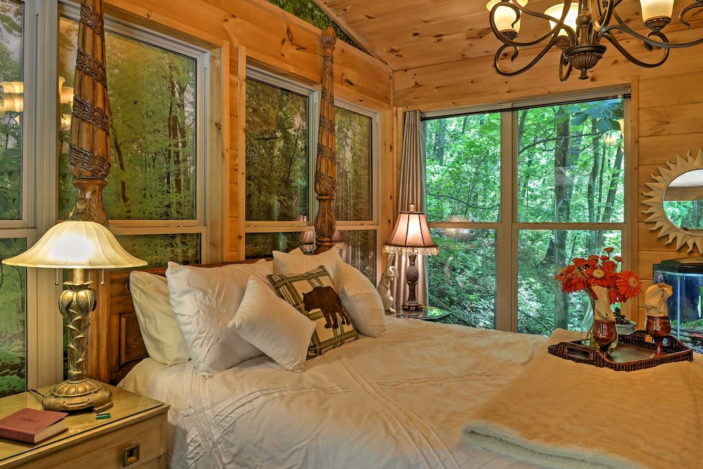 The bedroom features floor-to-ceiling windows for a truly tranquil environment.