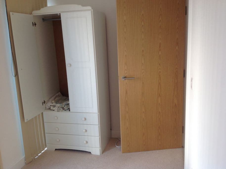 3.7x1.9m room with wardrobe, drawers and tv.