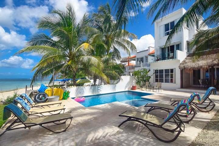 large pool deck with lounge chairs and beach towels provided