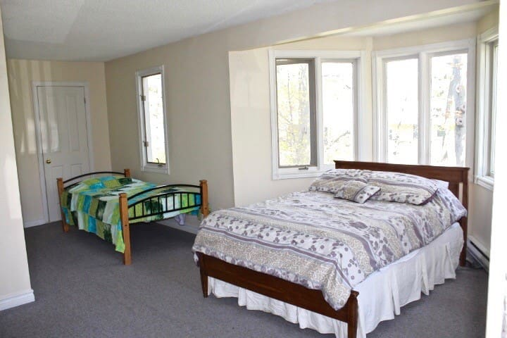 Large upper level bedroom with double and single bed