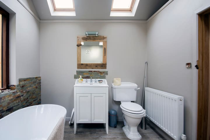 The bathroom which includes a  power shower.