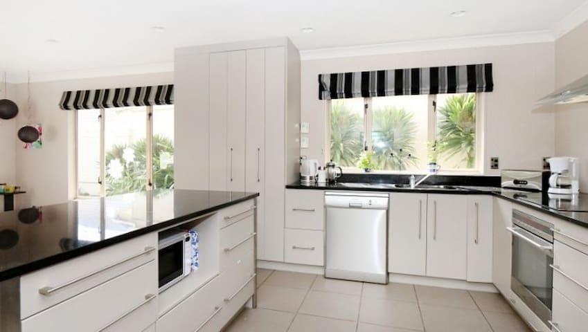 Modern kitchen with granite bench top