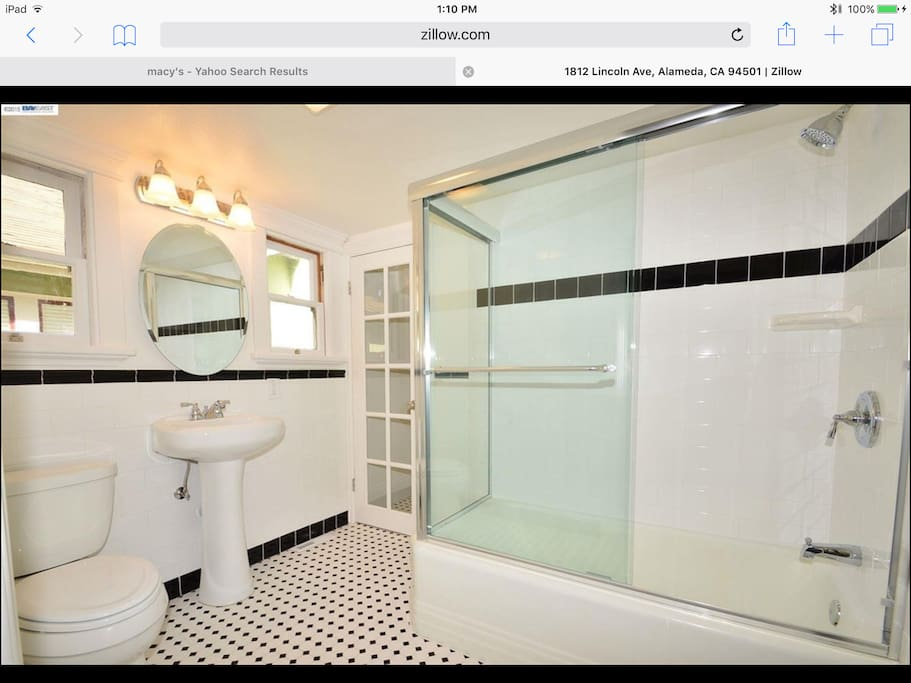 Shared bathroom across from the bedroom. Shared with the house host