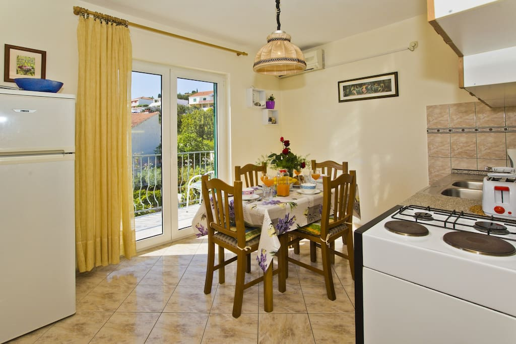 Fully equipped kitchen with the doors to the balcony