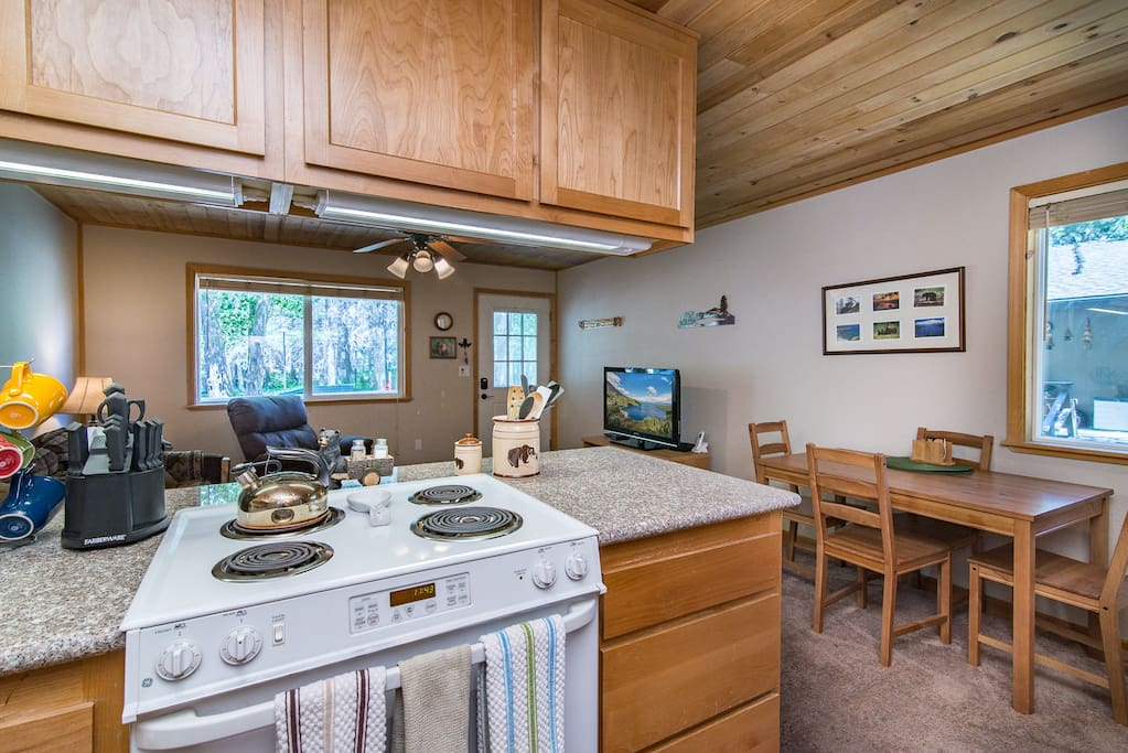 An open kitchen looks out over the living and dining areas for a true group vacation.