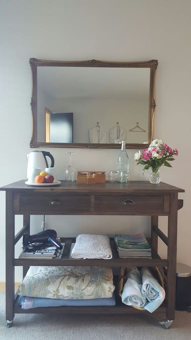 Sideboard with refreshments,fruit, flowers ...its the little things...