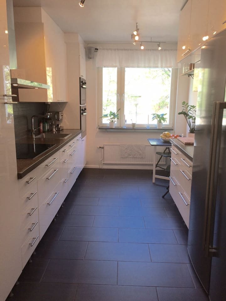 Fully equipped kitchen with heated floor.