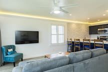 Livingroom features a 55# flat screen / HD smart TV & fullsize sleeper sofa