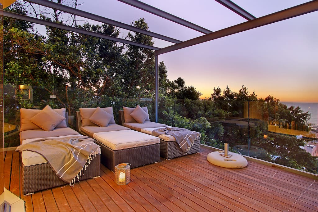 Daybeds on patio with views