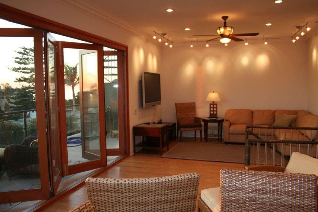 Spacious Living Area upstairs and water views. High Ceilings