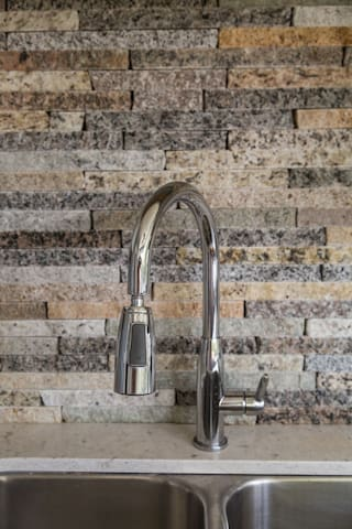 Backsplash was created by local artist using recycled granite.