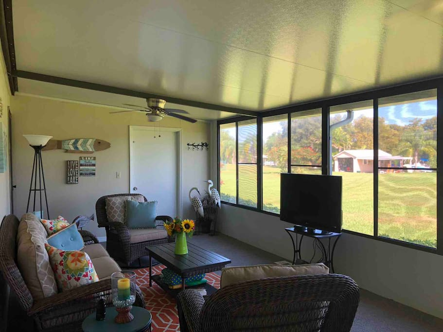 Air Conditioned back porch. Views of Taylor Creek from couch.