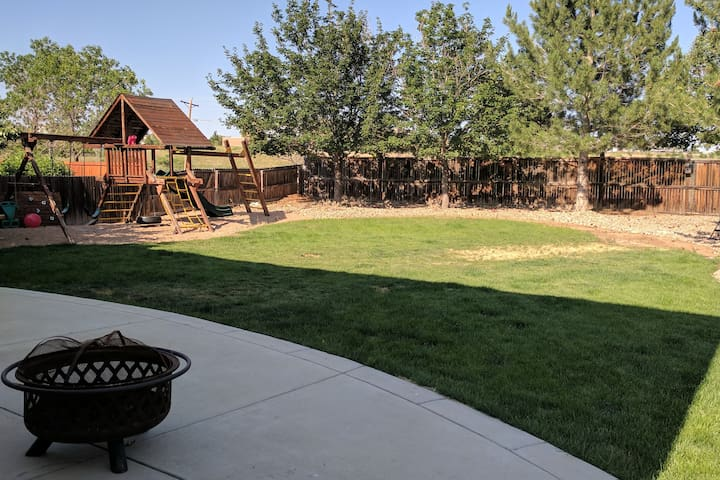 Large backyard w/fire pit, playground, & backyard games. Outdoor projector and screen available upon request. Gate access to miles of walking trails & short 200 yards to community tennis courts, skate park, basketball court, park, and baseball field.