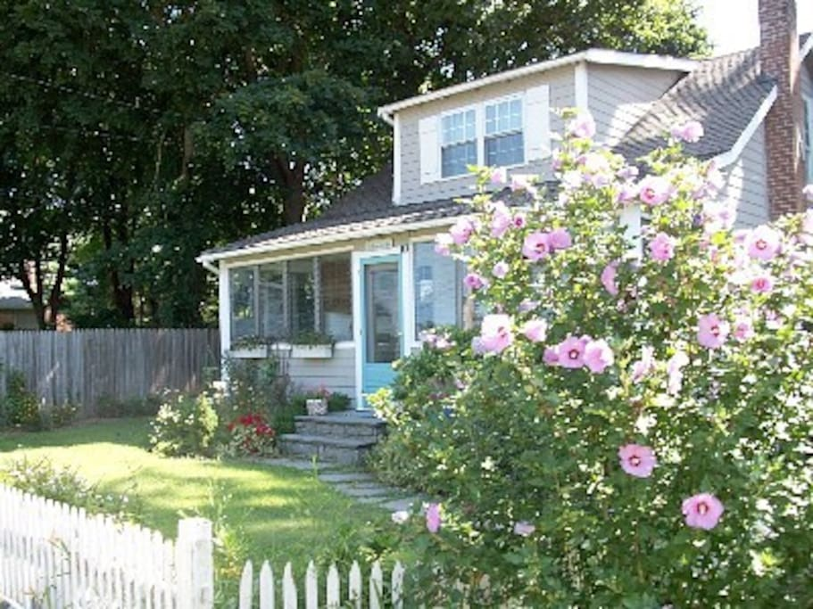 Rose Garden.  Large grassy lawn.  Mature Shade trees.  Beach Access Cottage