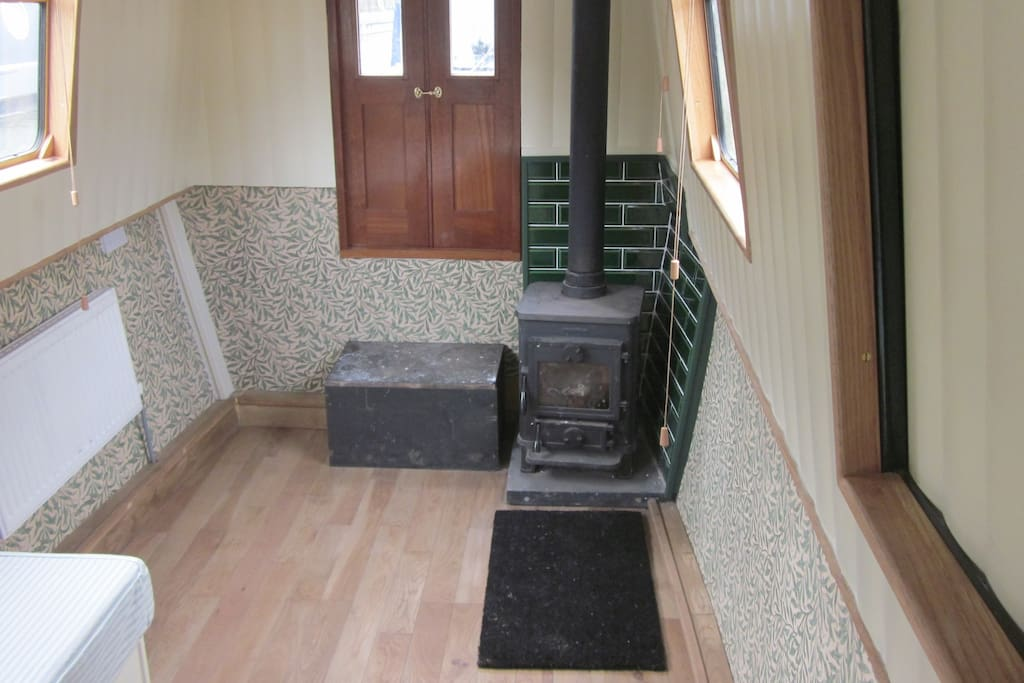 Saloon with multi-fuel stove and William wallpaper