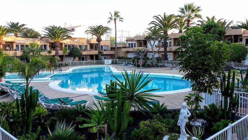 Appartamento PARADISE con giardino piscina e wifi