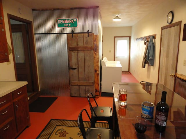 Entrance from front. Mud Room. Washer/Dryer.  Antique Rolling Barn Door to furnace/water/supply closet  Side door entrance to garage