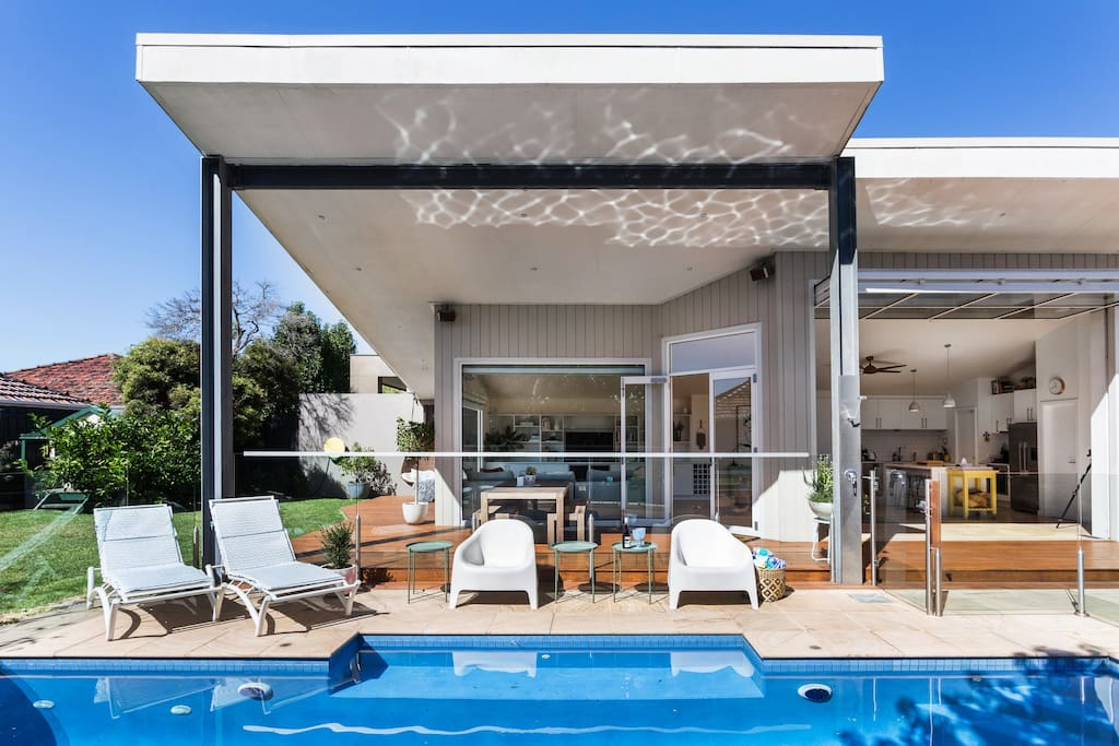 Large outdoor entertaining space - seamless indoor to outdoor hosting space.     Pool is gas heated as well as solar heated.  Be reassured you and your guests will be warm for a swim even during winter.
