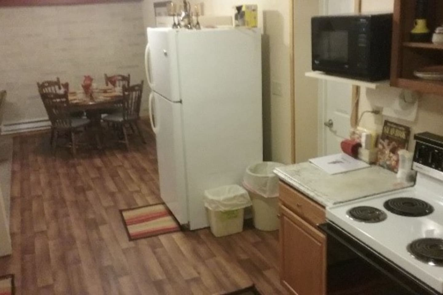 Lower level dining area  with full kitchen full size fridge, micro, toaster, coffee maker, and  stove