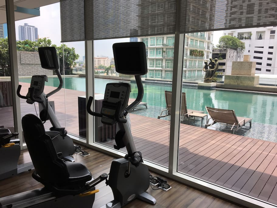 Fitness with swimming pool view